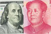 stock photo of yuan  - US one hundred dollar versus China Yuan currency - JPG