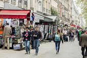 Tourists Walk Past A Cafeteria And Souvenir Store - Paris, France.