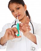 Indian doctor prepares syringe