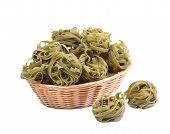 Italian pasta tagliatelle in basket.