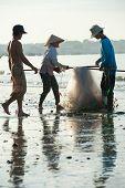 Vietnamese Fishers Pack Nets