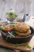 stock photo of veggie burger  - Vegan burgers with quinoa and vegetables served with arugula and salad