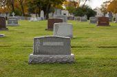Autumn cemetery grave stone tombstone
