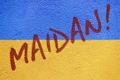 Maidan! Incription On Ukraine Flag Painted On Old Concrete Wall