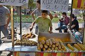 Young man sells corns