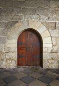Ancient Wooden Door In Old Stone Castle In Guimaraes, Portugal