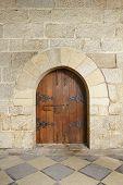 Wooden Door At Castle In Guimaraes, Portugal