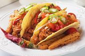 Mexican tacos with ground beef, chili salad and baby corn