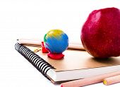 School Supplies With Globe And Notebook  On White Background