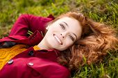 stock photo of cloak  - Outdoor portrait of beautiful redhead woman in red cloak - JPG