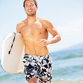 Handsome man surfer fun on summer beach. bodyboarding surfing good looking fit fitness model running