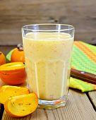Milkshake With Persimmons In Glass On Board