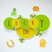 Happy St. Patrick's Day celebrations sticker, tag or labels with stylish text Lucky Day on grey background.
