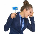 Frustrated Business Woman Cutting Credit Card