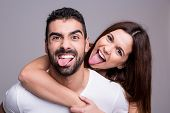pic of crazy face  - Portrait of a funny love couple hugging each other - JPG