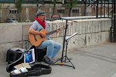 Guitarist on street.