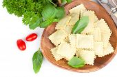 Homemade Pasta Ravioli With Fresh Basil, Isolated Over White Background.