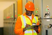 stock photo of substation  - african electrical engineer in substation control room - JPG