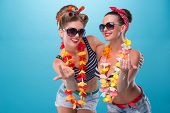 picture of hawaiian girl  - Full length portrait of two beautiful emotional coquette sexy girls with pretty smiles in pinup style with Hawaiian flowers necklaces - JPG