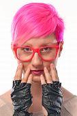 Pink hair woman punk portrait.Punk girl wearing gloves and eyeglasses.