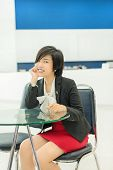 Cute Thai  Asian  businesswoman sitting in the office with a smiling welcome
