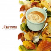 cozy cup of coffee and autumn leaves over white (with easy removable sample text)