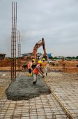 A group of construction workers casting floor slab