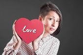 Young beauty posing with heart shape