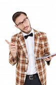 Happy nerd holding tablet pc and pointing on white background