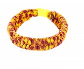 Survival Bracelet made from colorful Parachute cord using the fishtail weave