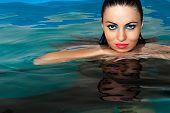 Fashion beautiful woman in the water
