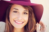 Closeup fashion portrait of young beautiful woman in hat