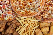 Fastfood Chicken Nuggets, Legs, Pizzas And Fry Potatos
