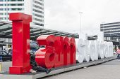 Schiphol Airport Control Tower With I Am Amsterdam Sign