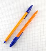 Two Pen On The Checked Paper