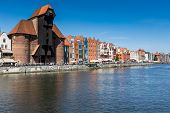 Gdansk, Poland - 07 August: The Medieval Port Crane Over Motlawa River On 07 August 2014. This Port
