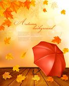 Retro autumn background with colorful leaves and an umbrella. Vector.