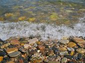 Nature Of Baikal. Pebble On The Water's Edge