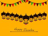Angry faces of Ravana with his ten heads and small colorful flags on yellow background for Happy Dussehra celebrations.
