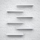 Empty shelves isolated on brick background.