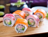 salmon and tuna sushi on a wooden tray