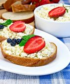 Bread With Curd And Berries On Blue Cloth