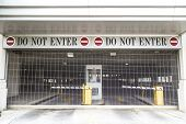 Do Not Enter Sign With Closed Roller Blind At A Garage