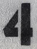 Number Four On Asphalt