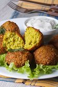 Falafel On Lettuce Leaves With Tzatziki Sauce, Vertical
