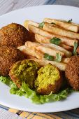 Falafel With French Fries, Salad On The White Plate Vertical