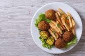 Falafel With French Fries, Lettuce Top View Horizontal