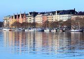 STOCKHOLM, SWEDEN - JANUARY 5, 2012: Boats moored at the embankment in a winter day. Stockholm archi
