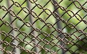 Detail Of An Old Rusting Chain Fence