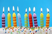 image of birthday-cake  - Nine birthday candles on a blue background - JPG